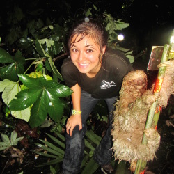 Ari posing next to a three-toed sloth in Costa Rica
