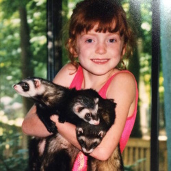 Nicki's love for animals started early - here she is holding ferrets when she was little.